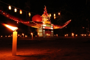 Lanterns, candles and boats decorate Luang Prabang's streets for the end of Buddhist Lent festival.