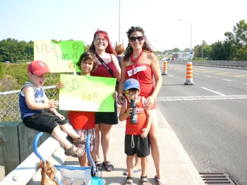 Get a cheer squad! (Here's one I had for the Quebec marathon in August 2012.)