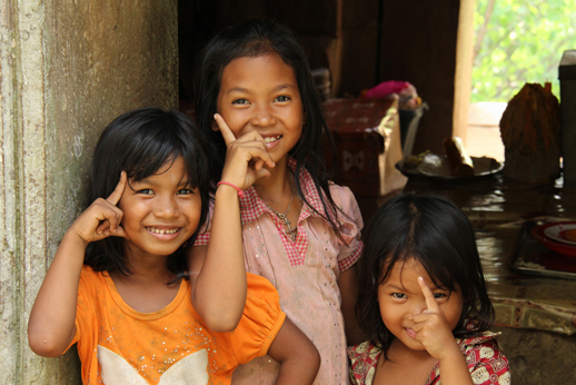 Three playful girls in the ruins of a temple, Battambang Province, Cambodia (Oct 2012)