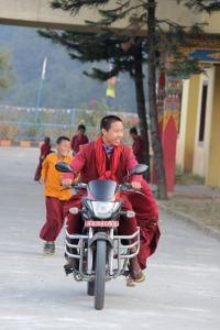 Lekshey, riding a monastery guest's motorbike